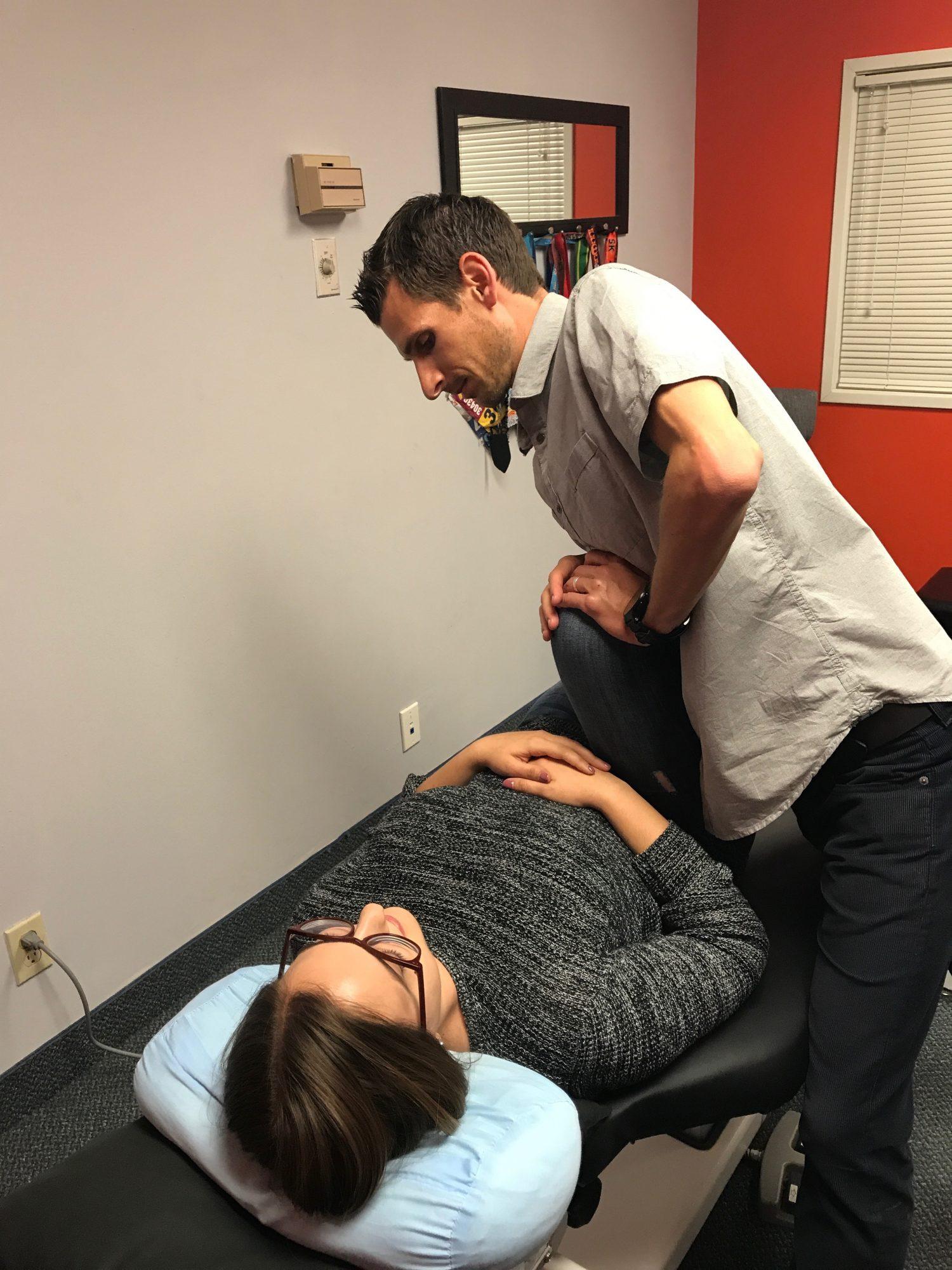 James Lander adjusting a chiropractic patient